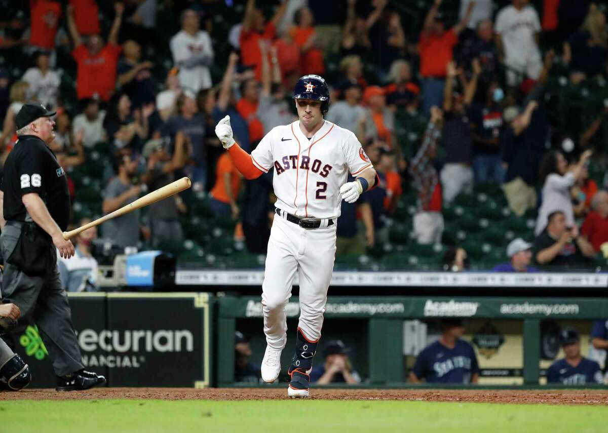 Houston Astros Alex Bregman (2) flips his bat after hitting a game-tying two run home run off Seattle Mariners relief pitcher Paul Sewald during the ninth inning of an MLB baseball game at Minute Maid Park, Tuesday, September 7, 2021, in Houston.