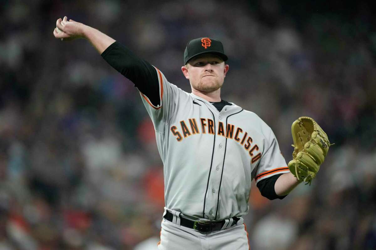 San Francisco Giants starting pitcher Logan Webb throws to first base to retire Colorado Rockies' Brendan Rodgers to end the third inning of a baseball game Tuesday, Sept. 7, 2021, in Denver. (AP Photo/David Zalubowski)