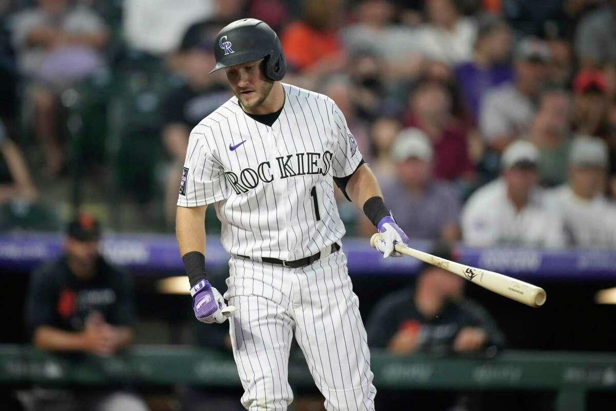 Colorado Rockies' Garrett Hampson reacts after striking out against San Francisco Giants starting pitcher Logan Webb during the second inning of a baseball game Tuesday, Sept. 7, 2021, in Denver. (AP Photo/David Zalubowski)