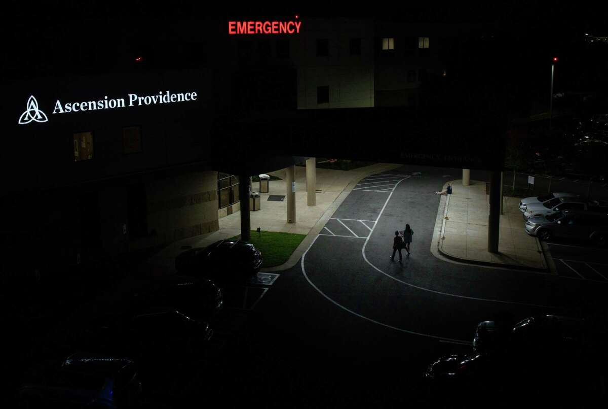 People walk into the emergency room at Ascension Providence Hospital in Waco on a summer night in 2021. Over the course of three days in January 2020, Stetson Hoskins found himself in this emergency room multiple times, attempting to get help for his bipolar disorder and schizophrenia.