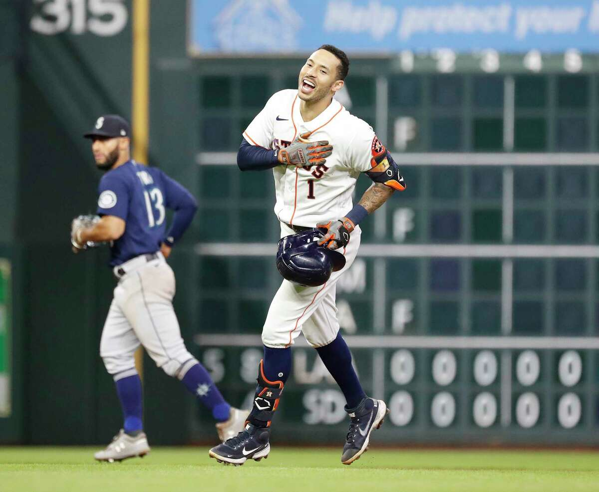 Houston Astros Carlos Correa (1) reacts after his double off Seattle Mariners relief pitcher Yohan Ramirez scored the winning run during the tenth inning of an MLB baseball game at Minute Maid Park, Tuesday, September 7, 2021, in Houston.