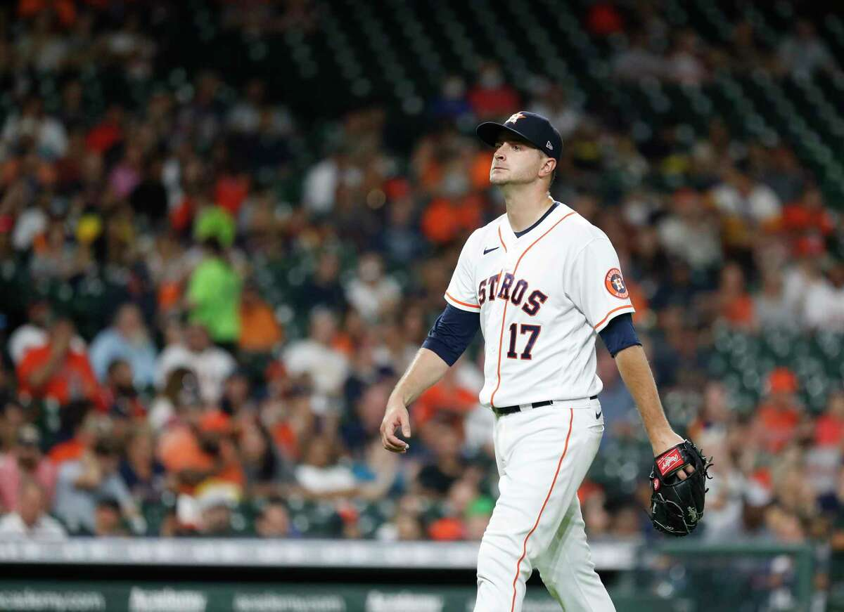 Houston Astros starting pitcher Jake Odorizzi (17) walks back to the dugout after striking out Seattle Mariners Mitch Haniger (17) during the third inning of an MLB baseball game at Minute Maid Park, Tuesday, September 7, 2021, in Houston.