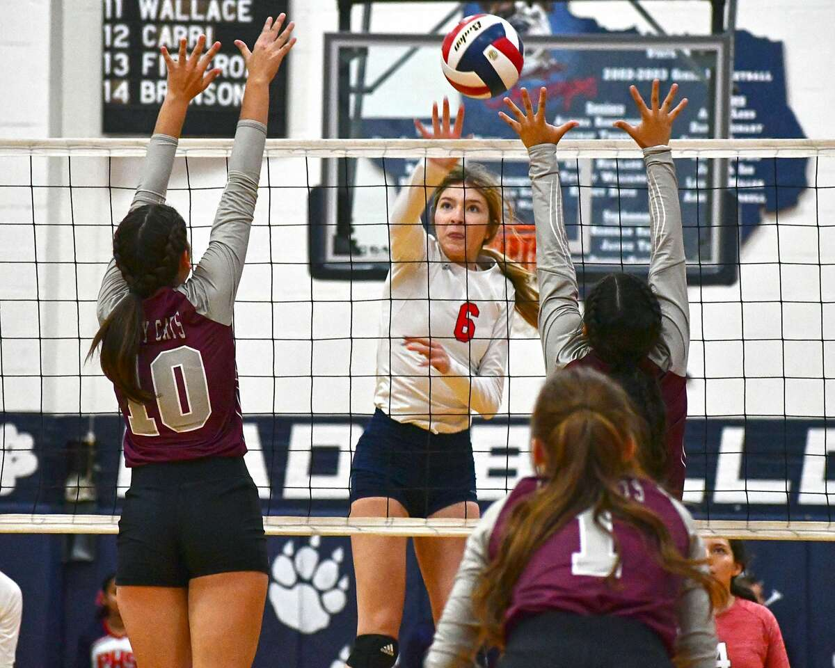Plainview's Adri Martin sends a hit over the Littlefield defense during a non-district volleyball game on Tuesday in the Dog House.