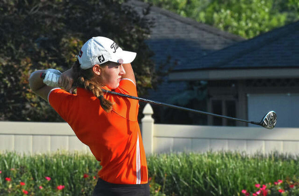 Edwardsville's Nicole Johnson follows through on her tee shot on No. 18 at Tamarack Golf Course during the O'Fallon Invitational on Tuesday in Shiloh.