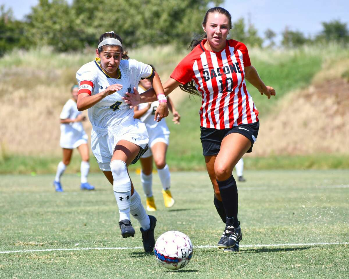 WBU's Bianca Roman chases after the ball with a Bacone defender. Roman set a program record with 13 shots in the Pioneers' 9-0 win.