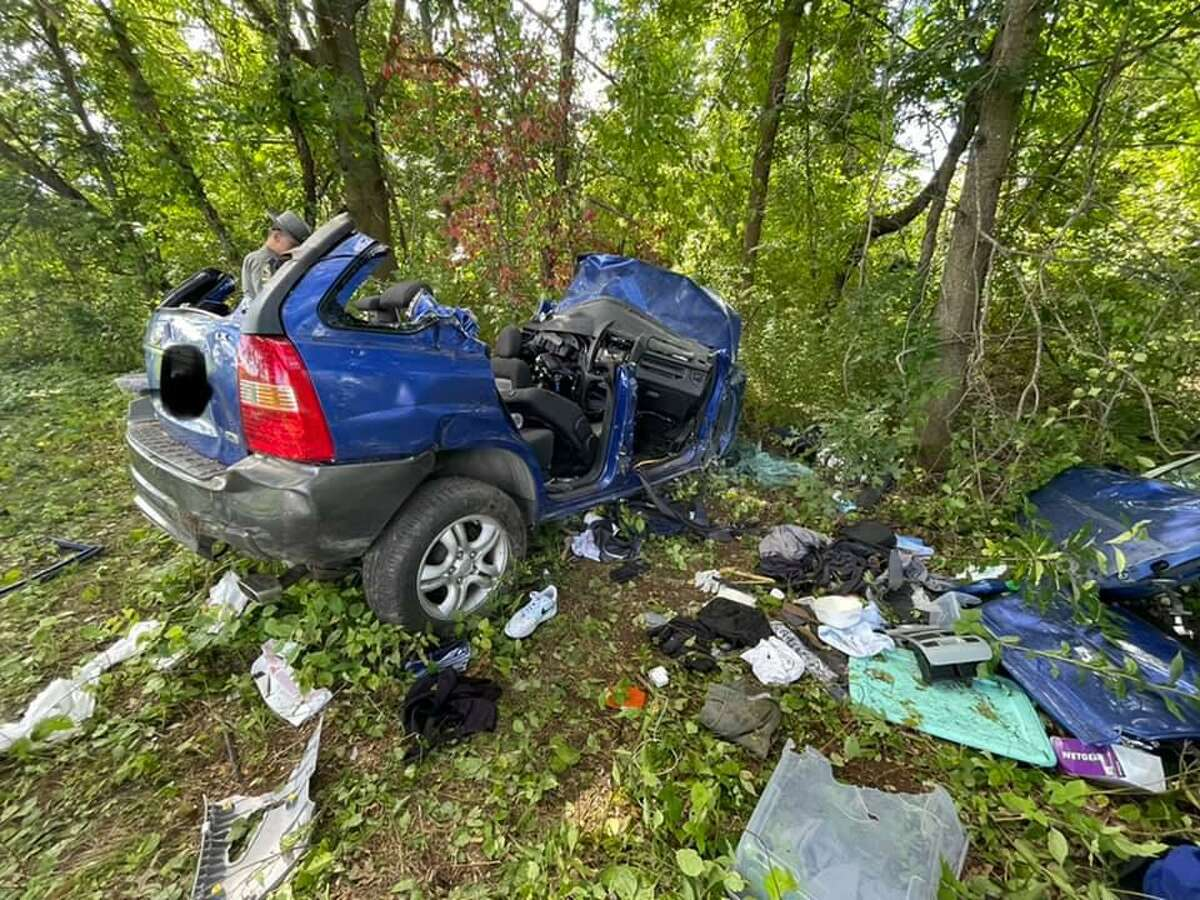 Fire officials said it took crews less than 30 minutes to free a driver, who was pinned between the dashboard and the engine compartment, on Interstate 91 near Exit 44 in East Windsor, Conn., on Tuesday, Sept. 7, 2021. Editing to the license plate was done by the fire department.