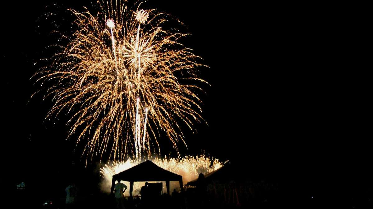 Rockets burst over Long Island Sound off West Haven's Bradley Point at the West Haven Centennial Celebration fireworks on Friday.