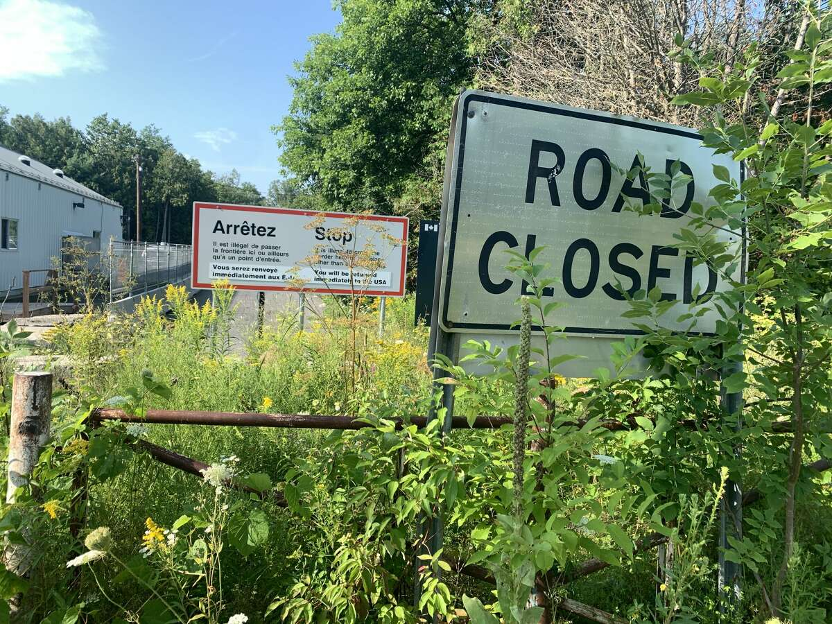Signs at Roxham Road warn crossers that the act is against Canadian law. (Rebekah F. Ward/Times Union)