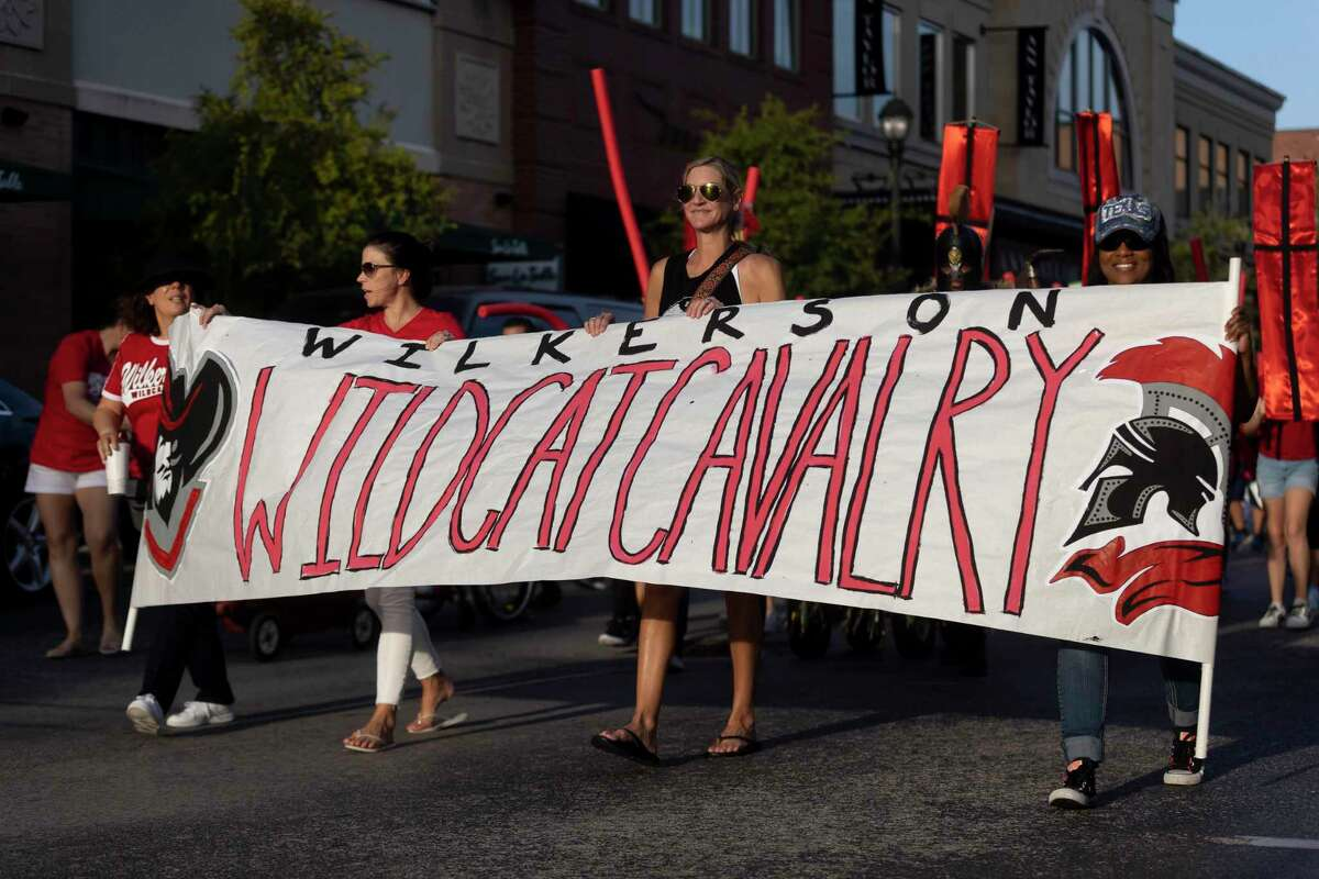 Marchers display a Wilkerson Intermediate school banner during College Park High School's homecoming parade and prep rally at Market Street, Tuesday, Sept. 7, 2021, in The Woodlands. Wilkerson Intermediate is usually where students attend before transitioning to The Woodlands College Park High School.