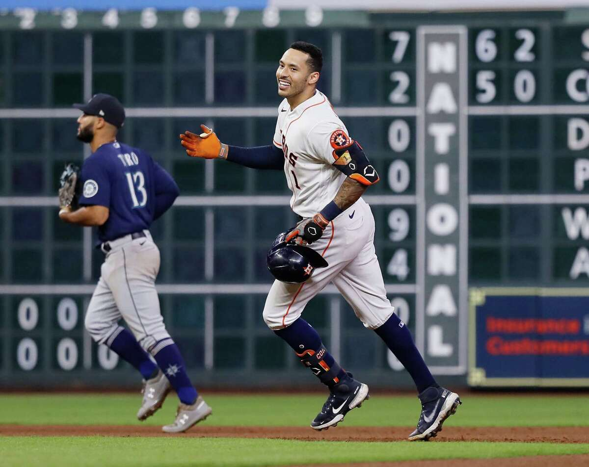 Carlos Correa of the Houston Astros hits a walk-off double to beat the Seattle Mariners in the tenth inning at Minute Maid Park on September 07, 2021.