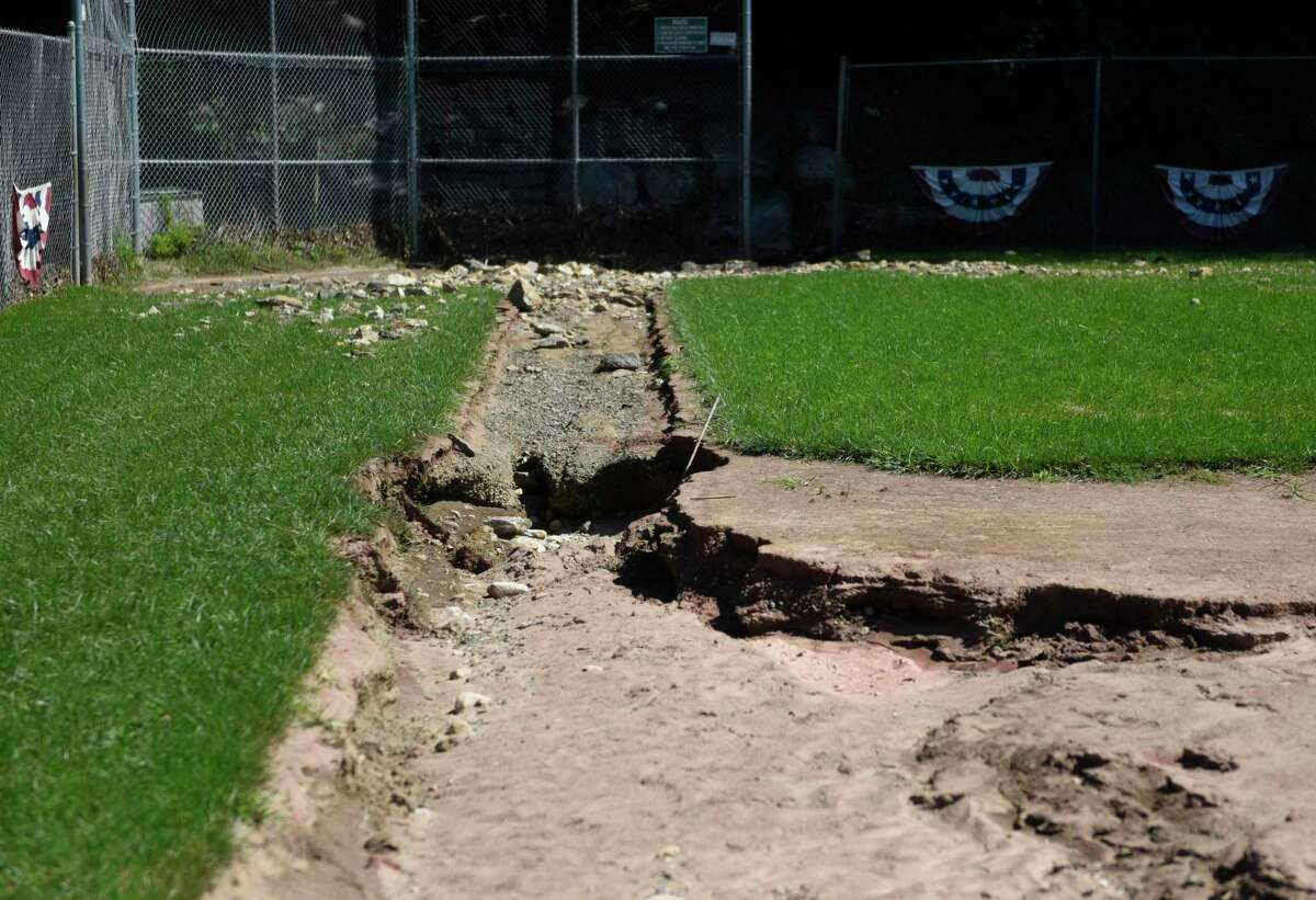 The Pemberwick Park baseball field is damaged from flooding in the Pemberwick section of Greenwich, Conn. Tuesday, Sept. 7, 2021. The ball field got washed out from last week's heavy rainfall from the remains of Hurricane Ida.