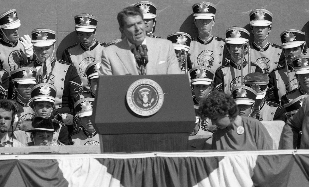 President Ronald Reagan liked to say government was the problem, and private enterprise was the solution. Americans have bought in, lock, stock and barrel. Reagan speaks to the crowd at DeAnza College.