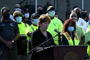 Albany Mayor Kathy Sheehan announces bonuses and raises for city workers from the AlbanyÕs allocation of its $80.7 million in American Rescue Plan funding on Wednesday, Sept. 8, 2021, during a press conference outside the Department of General Services headquarters in Albany, N.Y. Unionized city workforce members would receive an average bonus payment of nearly $3,700 for services during the pandemic. Non-unioized workers to get 3 percent retroactive raises for 2021, in addition to a $1,000 stipend for frontline non-union employees.