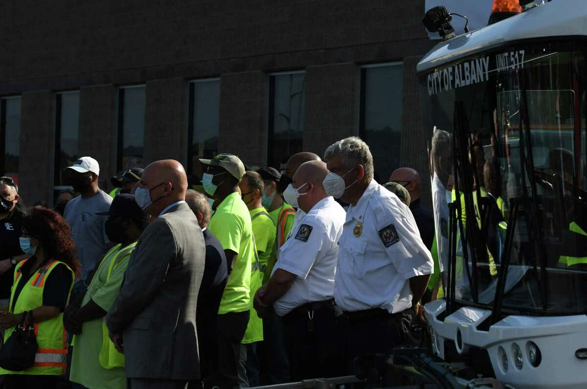 City of Albany workers attend a press conference where Mayor Kathy Sheehan announced bonuses and raises for city workers from Albany?•s allocation of its $80.7 million in American Rescue Plan funding on Wednesday, Sept. 8, 2021, outside the Department of General Services headquarters in Albany, N.Y. Unionized city workforce members would receive an average bonus payment of nearly $3,700 for services during the pandemic. Non-unioized workers to get 3 percent retroactive raises for 2021, in addition to a $1,000 stipend for frontline non-union employees.