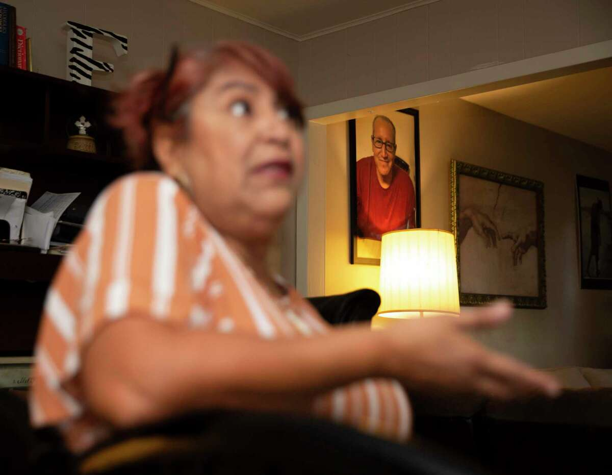 A photograph of Albert Ramirez hangs on the wall as Esmeralda Trigo talks about her brother, who died in June in the custody of the Fort Bend County sheriff's office, Tuesday, Aug. 24, 2021, at her home in Rosenberg. Ramirez had been jailed for 16 months on an aggravated robbery charge when he died. Preliminary autopsy results show he died from natural causes, including cirrhosis of the liver. However, his family has hired a lawyer and is questioning whether he received the right medical care.