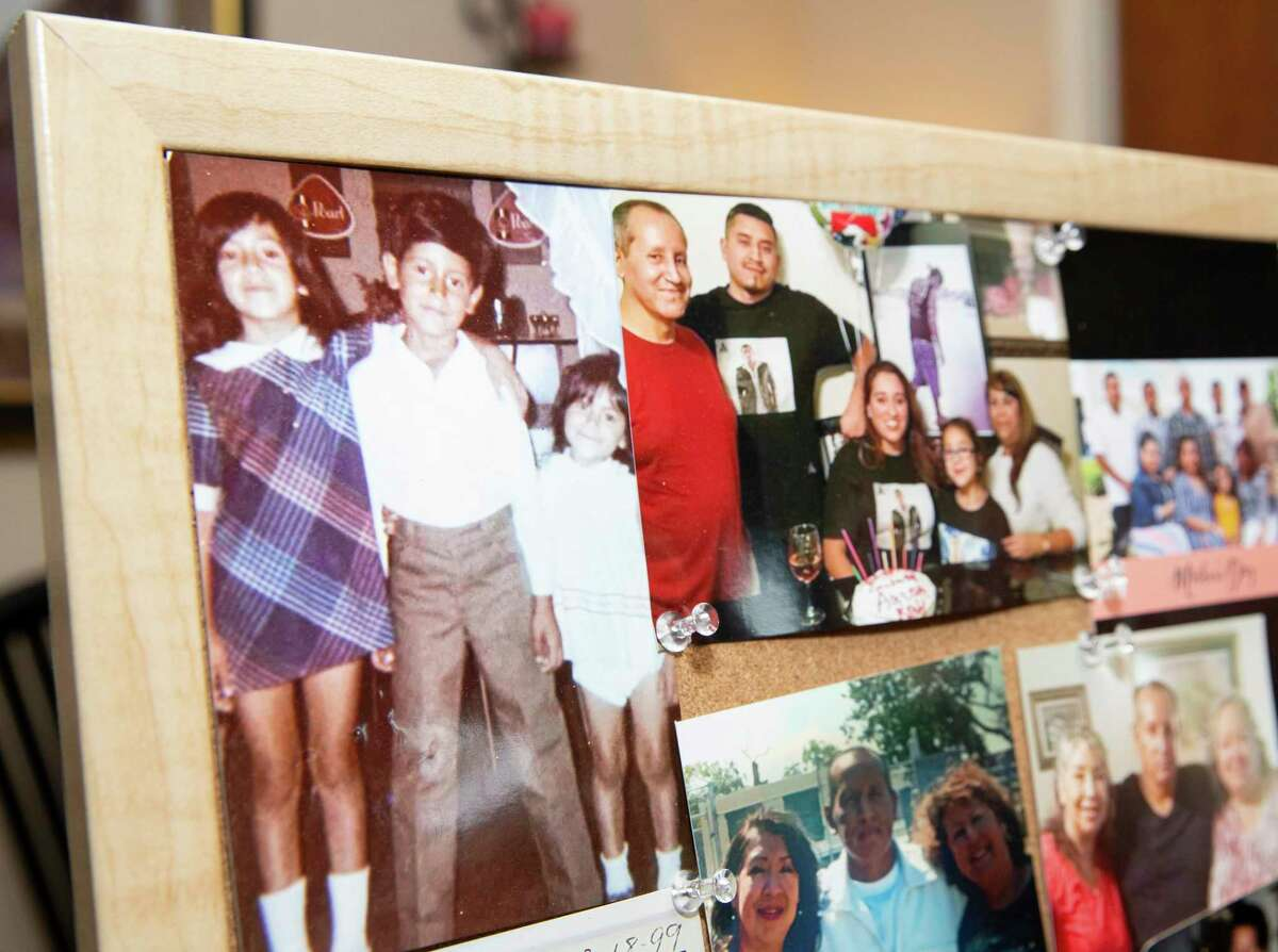 Esmeralda Trigo shows a collage of family photos of her brother, Albert Ramirez, who died in June in the custody of the Fort Bend County sheriff's office, Tuesday, Aug. 24, 2021, at her home in Rosenberg. Ramirez had been jailed for 16 months on an aggravated robbery charge when he died. Preliminary autopsy results show he died from natural causes, including cirrhosis of the liver. However, his family has hired a lawyer and is questioning whether he received the right medical care.