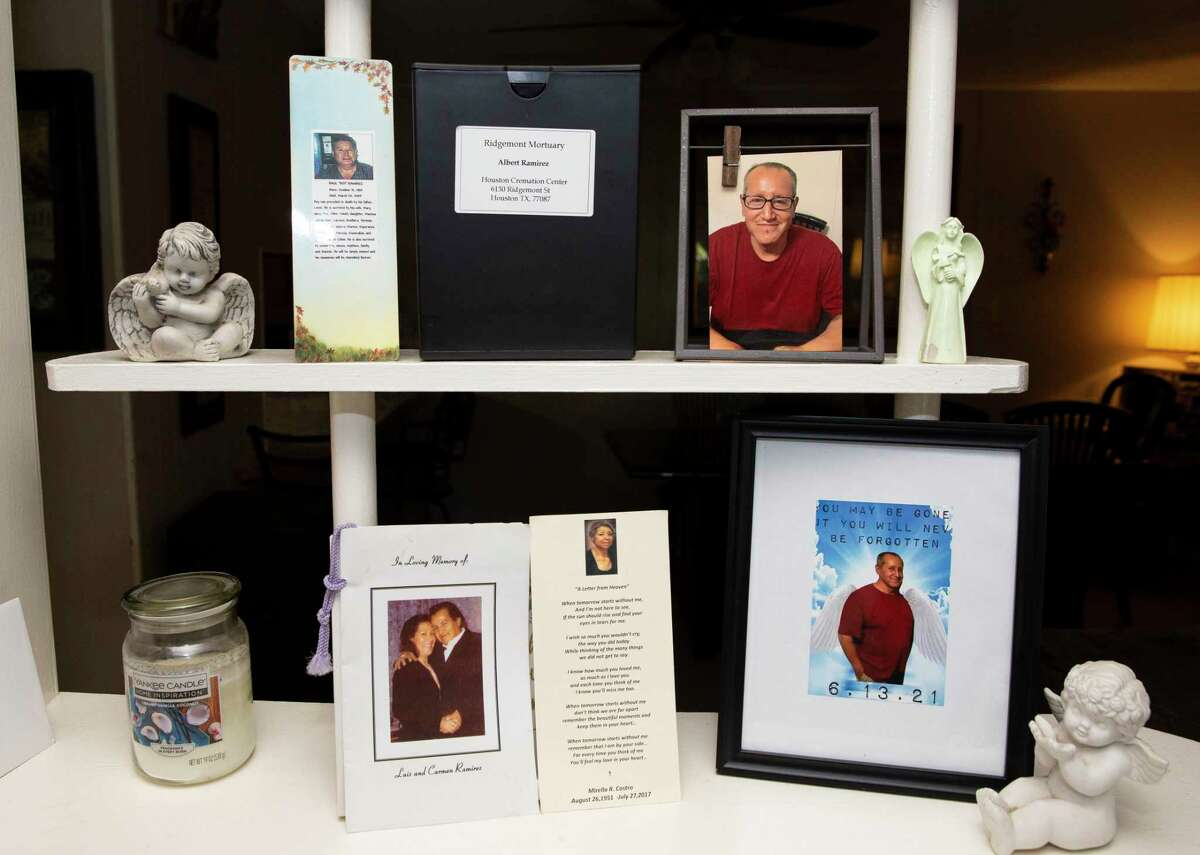 Photographs and a box containing the ashes of Albert Ramirez rest on a shelf at the Rosenberg home of his sister, Esmeralda Trigo, on Tuesday, Aug. 24, 2021. Ramirez died in June in the custody of the Fort Bend County sheriff's office after being jailed for 16 months on an aggravated robbery charge. Preliminary autopsy results show he died from natural causes, including cirrhosis of the liver. However, his family has hired a lawyer and is questioning whether he received the right medical care.