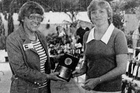 (Right) Becky Dinsen is the 1981 Manistee County Fair Homemaker of the Year. Dinsen was named and awarded a plaque at special activities Friday. Making the presentation was Corrine Hahn, Manistee County Extension Home Economist. The photo was published in the News Advocate on Sept. 9, 1981. (Manistee County Historical Museum photo)