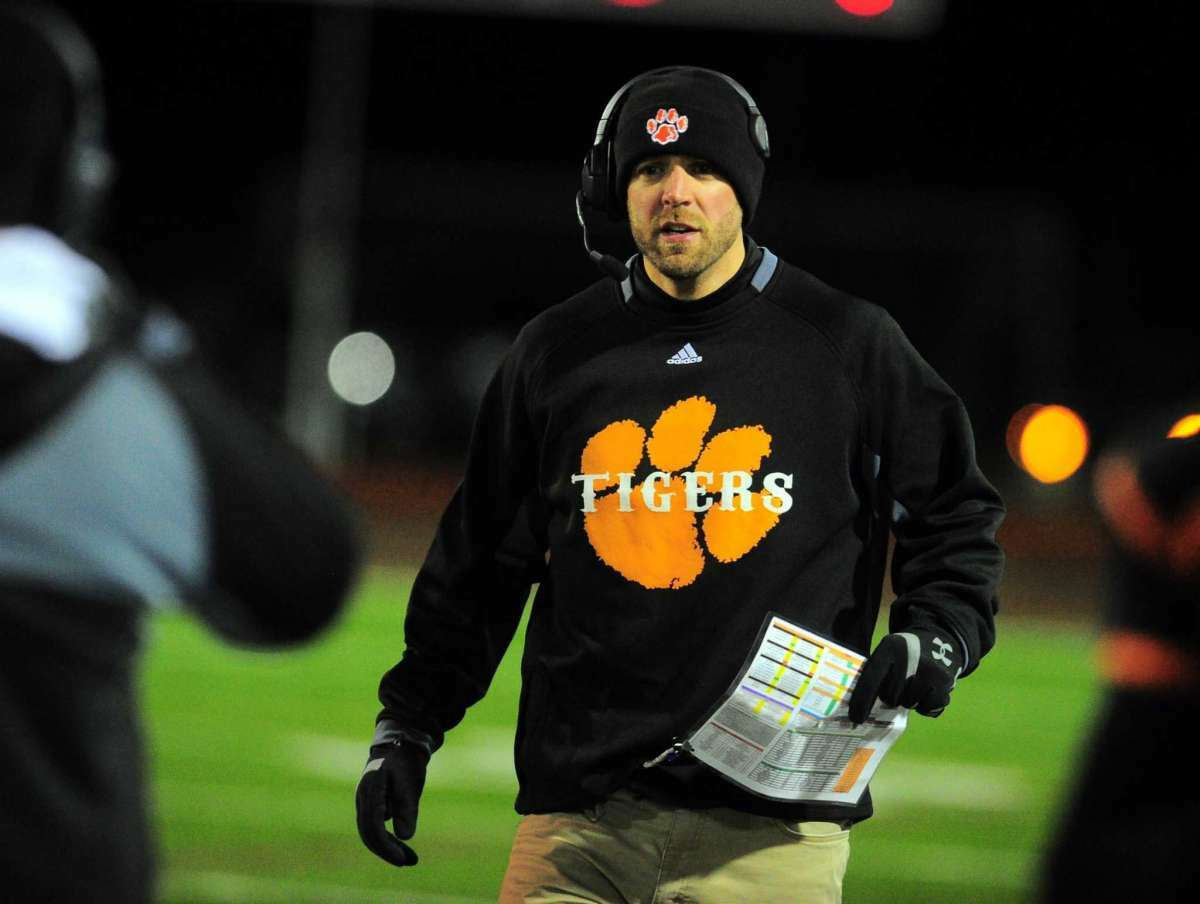Former Bullard-Havens coach Chris Pace encourages his team during the Class S quarterfinals against Haddam-Killingworth in Bridgeport in 2018.