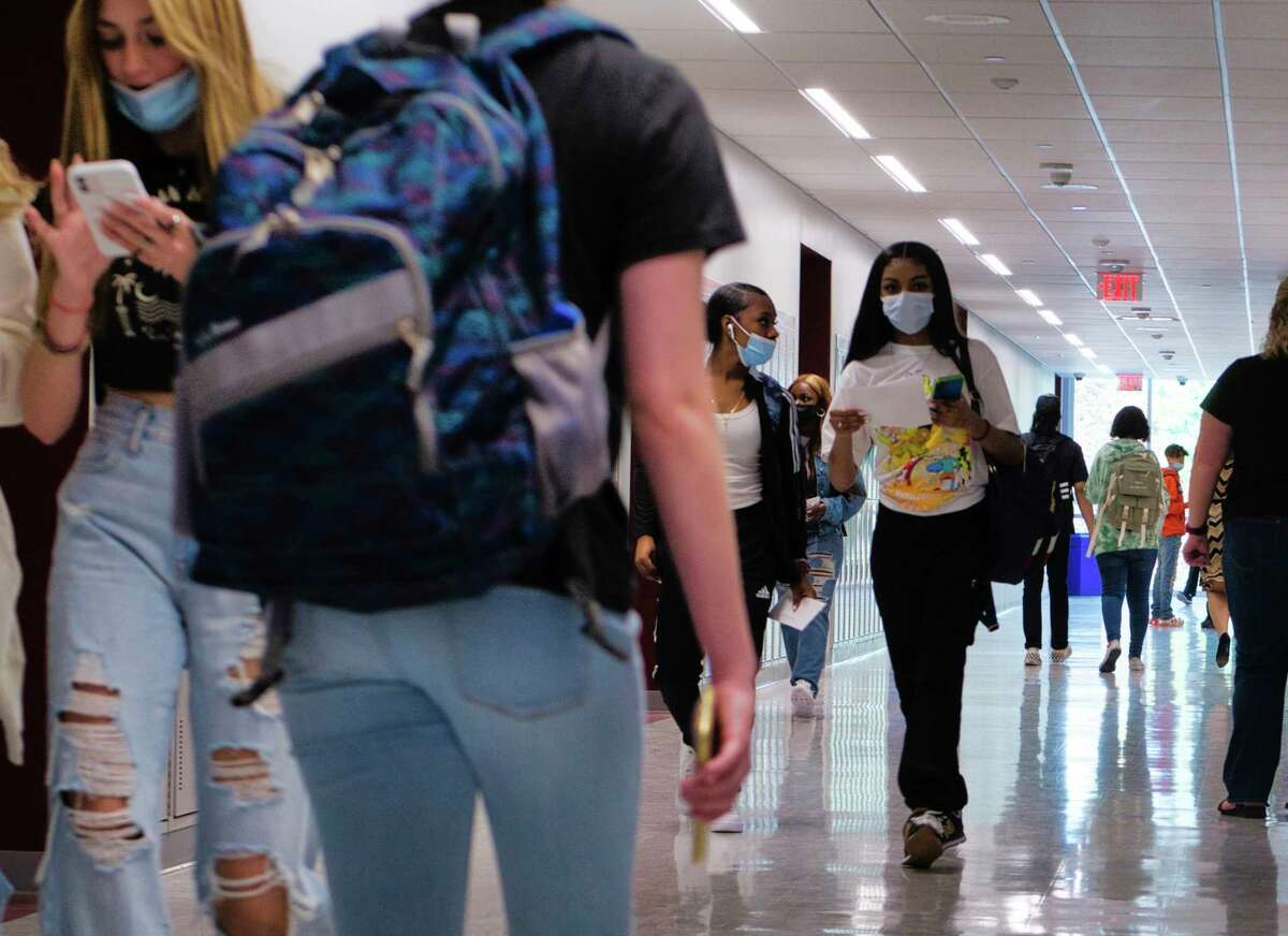 Albany High School students walk through the halls on the first day of classes on Wednesday, Sept. 8, 2021, in Albany, N.Y.