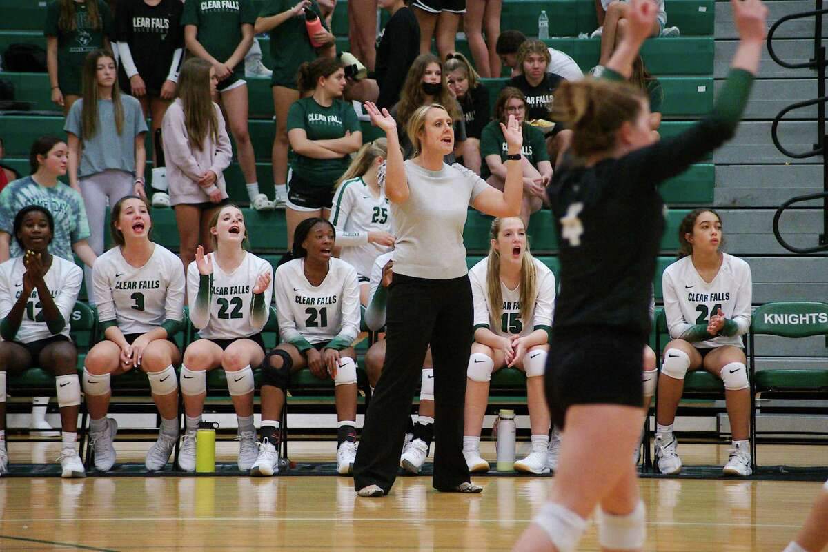 Clear Falls volleyball coach Alison Williams reacts as the Lady Knights play Shadow Creek Tuesday at Clear Falls High School.