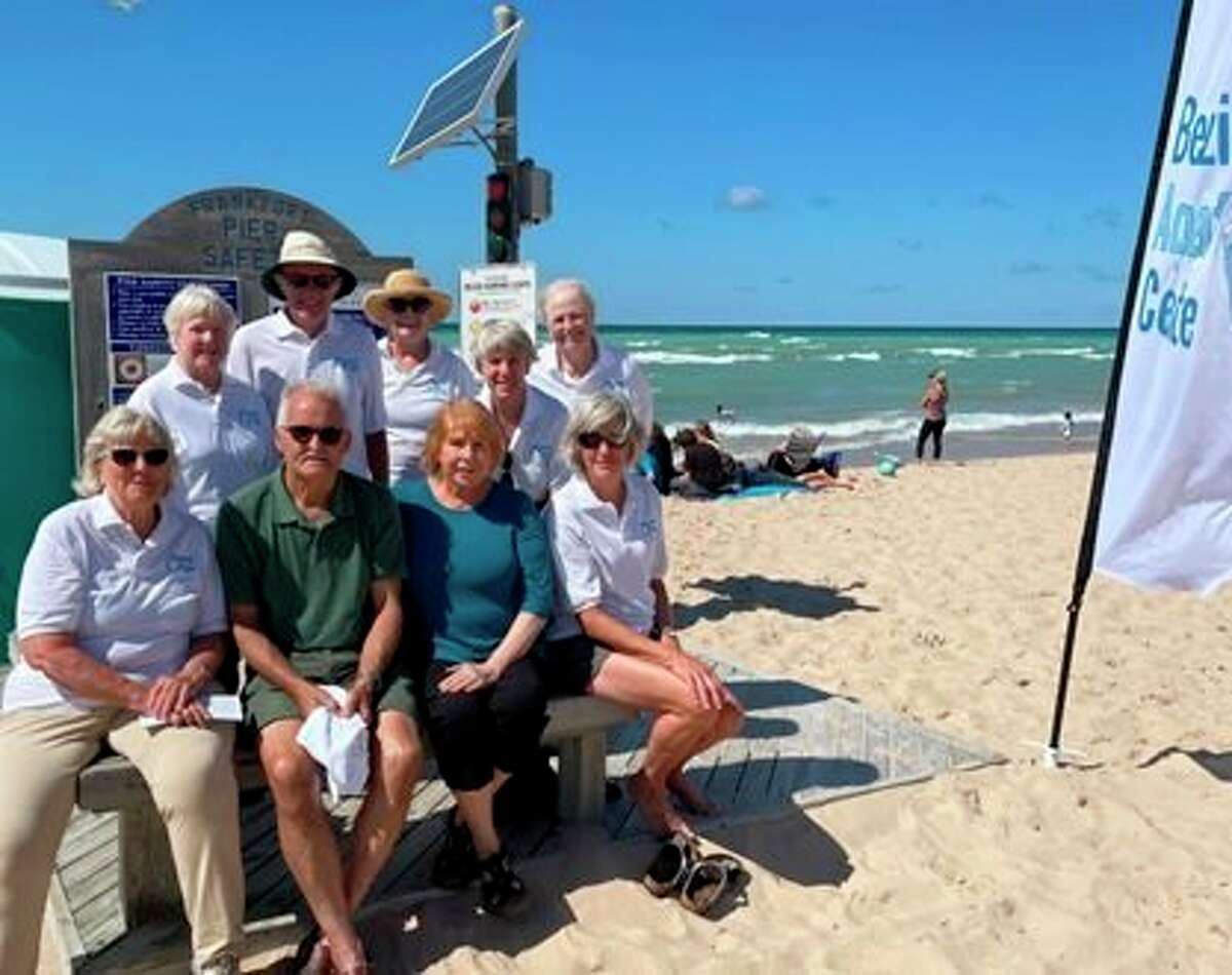 Sept. 5 was the final day for the Benzie Aquatic Center's pilot pier safety program at Frankfort's Lake Michigan beach for this summer. Pictured (front row, left to right)are Marjorie Pearsall-Groenwald, Layton Sutter, Colleen Sutter, Becky Bagnall;(back row) Barb Beck, Bob Beck, Carol Johnson, Diane Tracy and Beth Fitzsimmons. (Courtesy Photo)