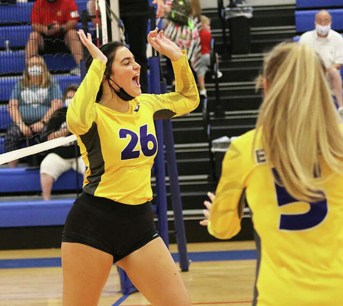CM's Camryn Gehrs (26), shown celebrating a point in an Eagles match Aug. 24 at the Roxana Tourney, had three kills Tuesday in a win over Southwestern in Bethalto.