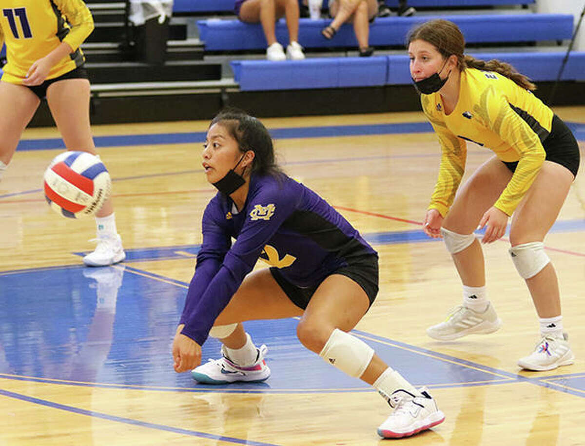 CM libero Ella Middleton receives a serve in front of DS Toni Reynolds in a match earlier this season. Middleton had seven digs Tuesday in the Eagles' win that pushed their record to 10-0.