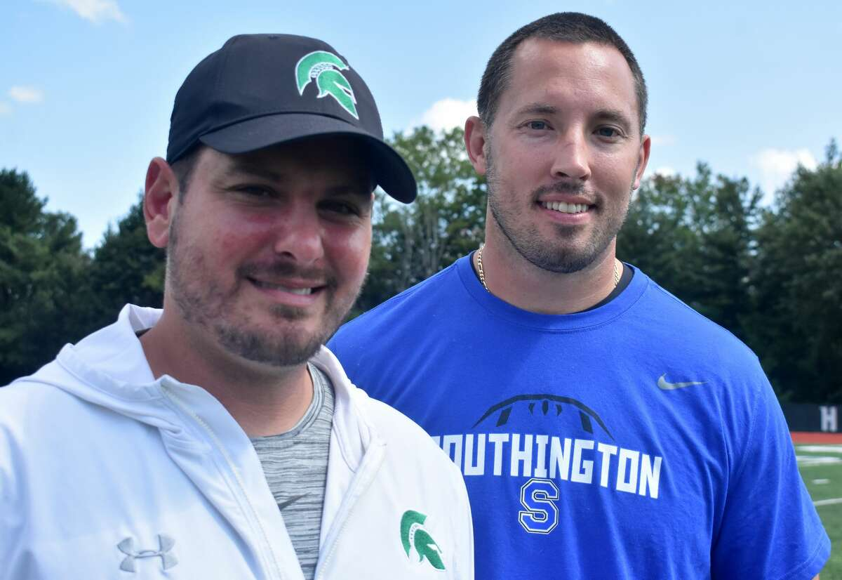 Maloney football coach Kevin Frederick and Southington coach Mike Drury, pose at Maloney high school, Meriden on Saturday, Sept. 4, 2021, have been best friends since college and will face off against each other for the first time in a CIAC game on Friday, Sept. 10, 2021 at Southington.