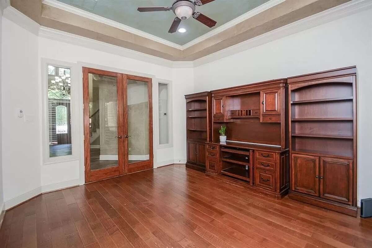 The office comes with the furniture and a set of French doors.