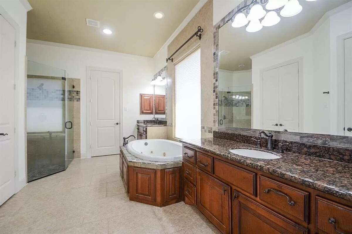 The primary bathroom has a Jacuzzi tub and a shower.