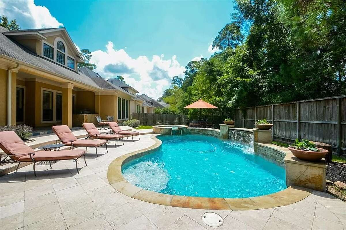 A sizable pool can be found in the backyard.