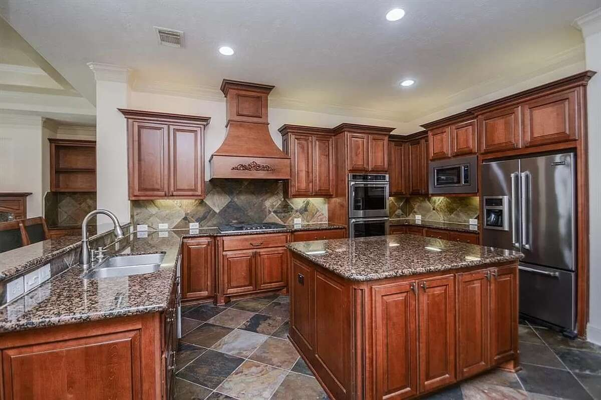 The kitchen has a gas range and two ovens.