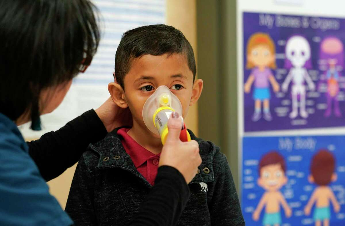 Myrna Sonia Garcia, the nurse at Parker Elementary School, 10626 Atwell Dr., gives first grader, Josue Flores, 6, his inhaler treatment for asthma in her office before he goes outside to play Friday, Nov. 1, 2019, in Houston. She says, out of the school's 912 students, 66 have medically diagnosed asthma. On days when ground-level ozone is high or unhealthy, Houston Independent School District schools are instructed to limit prolonged exercise for all children.