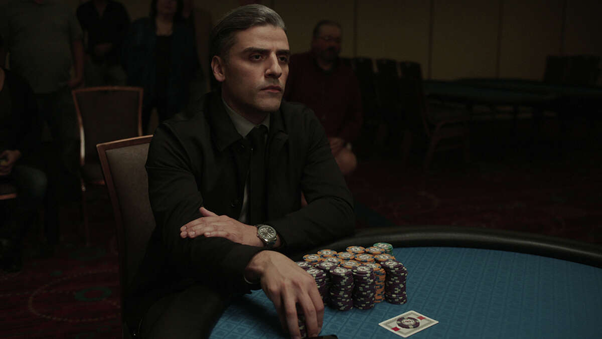 """""""You dealing to me?"""" Oscar Isaac's title character in """"The Card Counter,"""" the new film from writer-director Paul Schrader, is the latest in a long line of antiheroes that can be traced back to Travis Bickle in Schrader's screenplay for 1976's """"Taxi Driver."""""""