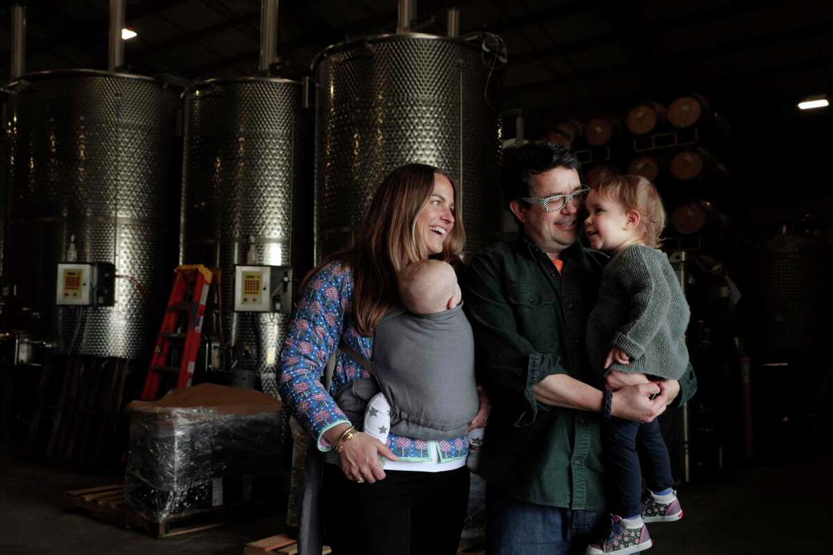 Winemaker Hardy Wallace with his wife, Kate Graham, and children Maple and Herve. The family is starting a new winery.