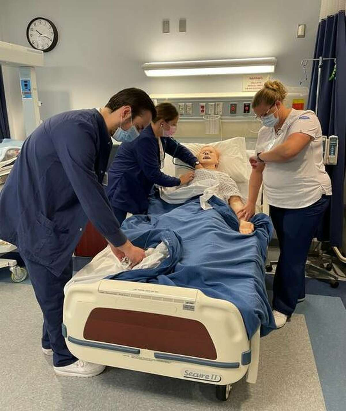 In this file photo, Lewis & Clark Community College nursing students practice on a simulation model in the Templin Nursing Building. Through Sept. 18 students can pre-register for their pre-entrance exams Oct. 6-9.