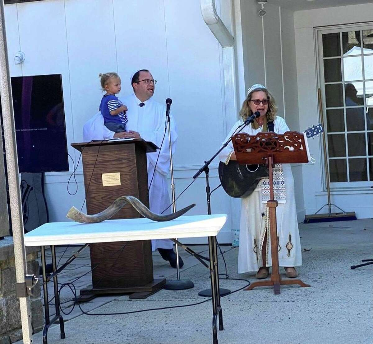 Rabbi David Reiner, left, and Cantor Deborah Katchko-Gray lead the Congregation Shir Shalom outdoor services for Rosh Hashana on Tuesday. On the table is the shofar, or ram's horn, which is blown on the holiday.