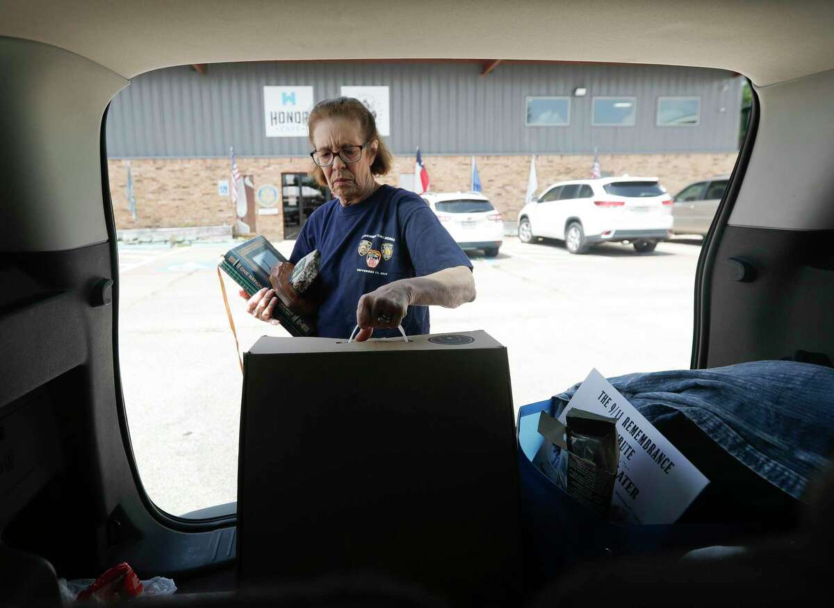 Vicky Tompkins unloads newspapers, magazines and several personal items from her time as a New York Police Department detective at Honor Café, Saturday, Sept. 4, 2021, in Conroe. Tompkins worked the scene at Ground Zero on Sept. 11, 2001 and later and at the Staten Island landfill where the debris was taken.