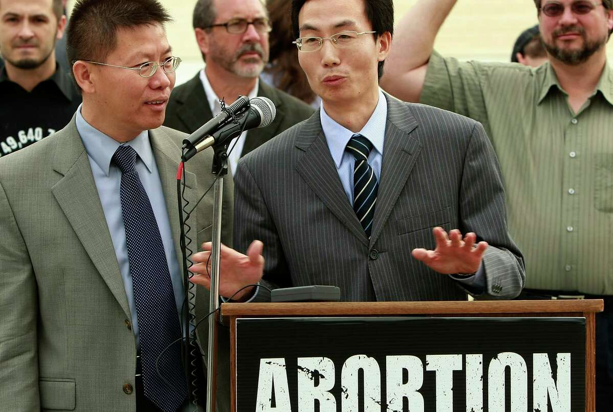 Lawyer Fangping Li (2nd R) was beaten by police in China for fighting to end the practice of forced abortion in 2008.