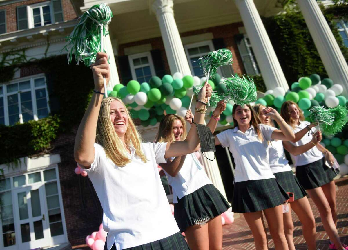 Annie O'Connor, left, and other seniors welcome underclassmen on the first day of school at Sacred Heart Greenwich in Greenwich, Conn. Wednesday, Sept. 8, 2021. Sacred Heart and other Greenwich private schools began their 2021-2022 school year on Wednesday, a week after Greenwich Public Schools.