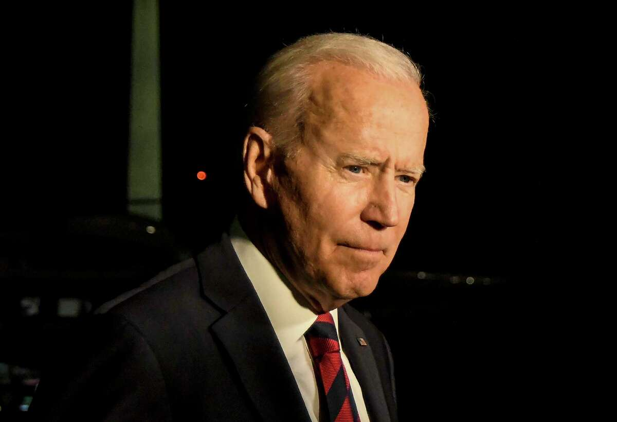 President Joe Biden takes questions from reporters upon returning to the White House in Washington late Wednesday, July 21, 2021, from a day trip to Cincinnati.