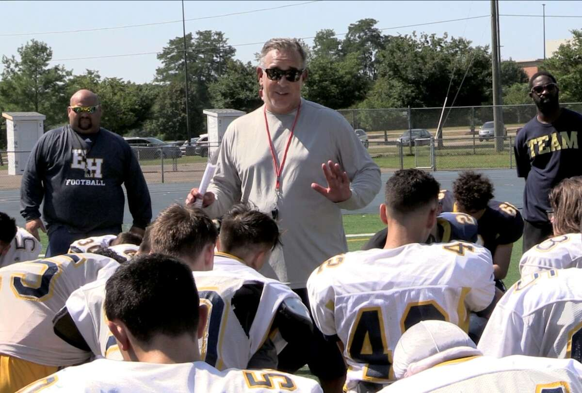 New East Haven coach Scott Benoit talks to his team after a joint practice with McMahon on Monday, Sept. 3, 2018.