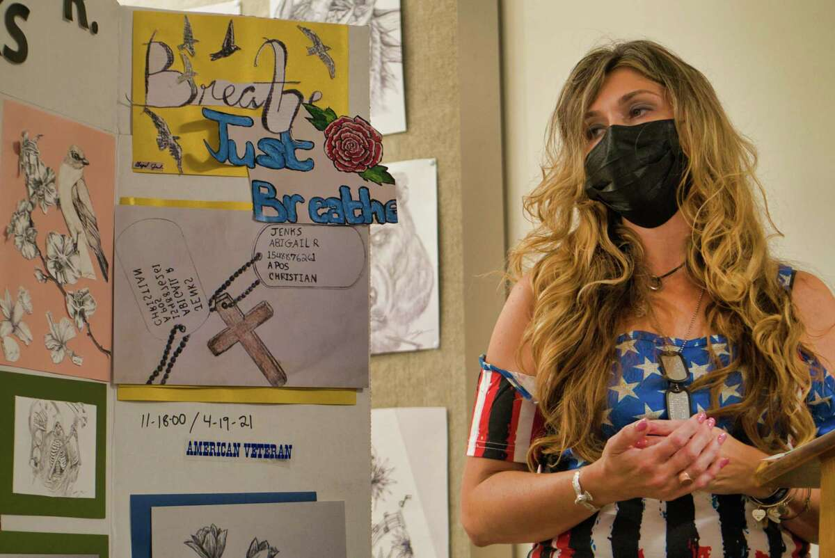 Mary Jenks, a nurse at Wesley Health Care Center, talks about her daughter, Abigail Jenks, during an opening of a show of Abigail's artwork at the Wesley Health Care Center on Wednesday, Sept. 8, 2021, in Saratoga Springs, N.Y. Abigail Jenks, a U.S. Army paratrooper, died in a training accident at Fort Bragg.