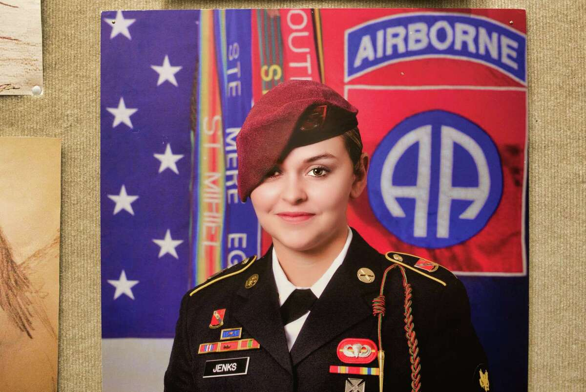 A photo of Abigail Jenks hangs on the wall as part of an exhibit of her artwork at the Wesley Health Care Center on Wednesday, Sept. 8, 2021, in Saratoga Springs, N.Y. Jenks, a U.S. Army paratrooper, died in a training accident at Fort Bragg.