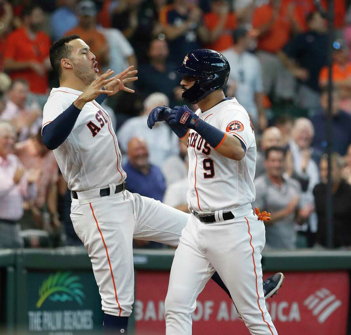 Houston Astros Marwin Gonzalez (9) celebrates with Carlos Correa after hitting a two-run home run off Seattle Mariners starting pitcher Tyler Anderson (31) during the second inning of an MLB baseball game at Minute Maid Park, Wednesday, September 8, 2021, in Houston.