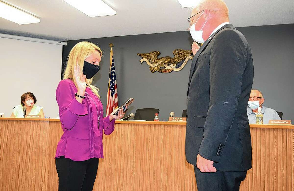 Trustee Mike Broaddus is sworn in Tuesday as South Jacksonville village president.