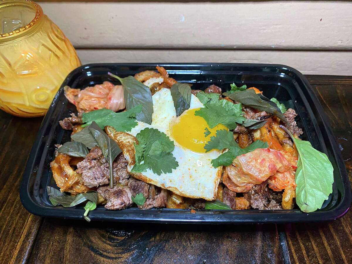 Bulgogi fries combine sweet and spicy beef with curly fries, kimchi, herbs and a fried egg at Mai-O-Mai, a food trailer specializing in Asian-Mexican fusion cooking.