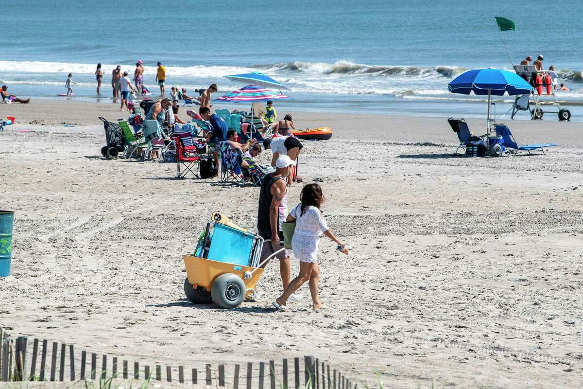 Beachgoers enjoy Labor Day in Sea Isle City, N.J. National data showed a spike in COVID-19 infections and hospitalizatiuons after the holiday weekend.