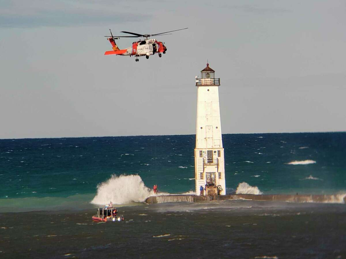 Two men were rescued by theU.S. Coast Guard Station Frankfortusing a helicopter when they were trapped on the pier at Frankfort by high wind and waves. (Courtesy Photo/Tom Hitchman)